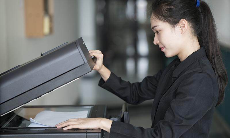 Woman using printer
